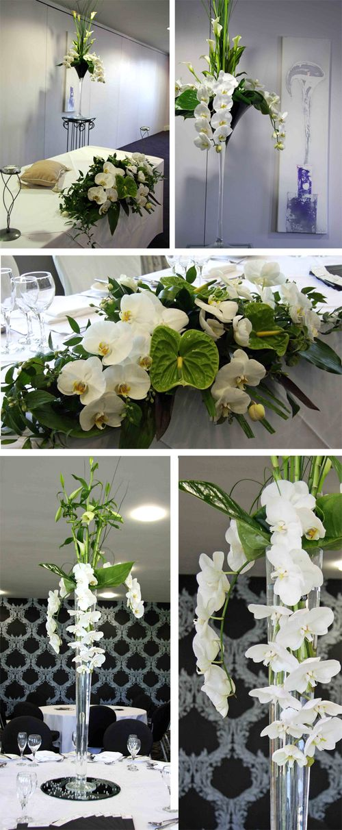 centerpieces using orchids anthuriums curly bamboo and calla lilies